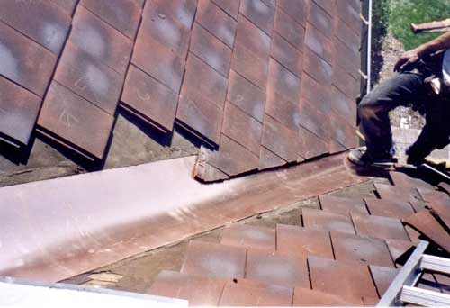 Interlocking tile roof valley replacement