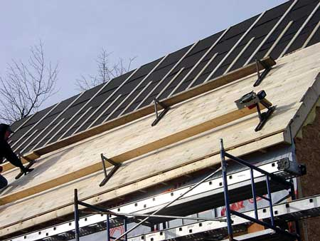 covering OSB with boards on a slate roof